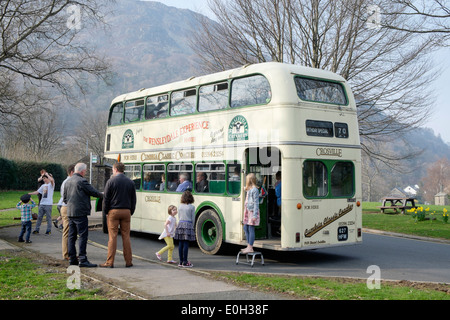 Classic old double decker bus hired as an aged 70 birthday special in Glenridding, Cumbria, England, UK, Britain - Stock Image