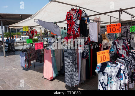ladies fashions  on display in a spanish market - Stock Image