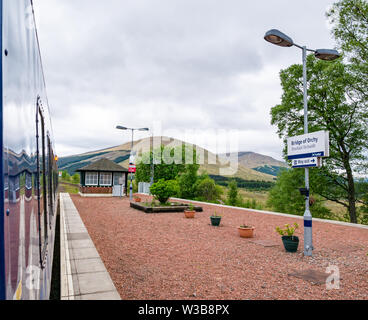 ScotRail Bridge of Orchy rural train station platform and name sign. ScotRail train on West Highland railway line, Scottish Highlands, Scotland, UK - Stock Image