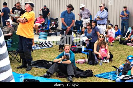 Mixed crowd of Australian people on the grass at Tyabb Airshow, watching a plane go up. - Stock Image