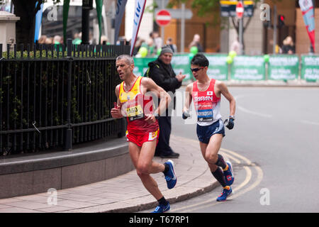 Alberto Suarez Laso (ESP),  and Tadashi Horikoshi (JPN), Competing in the 2019 London Marathon.  They went on to finish 3rd and 4th in times of 02:25:50 and 02:25:56 respectively (2nd and 3rd in the T11/12 Category). - Stock Image