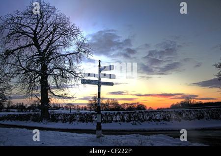 Budworth / Antrobus Sunset And Fingerpost - Stock Image