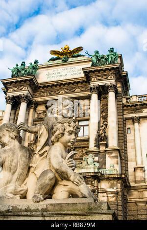 Little marble cherubs at Neue Burg building part of the Hofburg palace complex seen from Burggarten. Vienna, Austria. - Stock Image