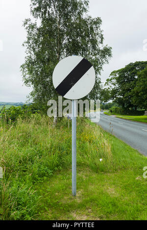 National speed limit sign on the A6 road north-east of Kendal, Cumbria. The road is a single carriageway without street lighting, so has 60 mph limit - Stock Image