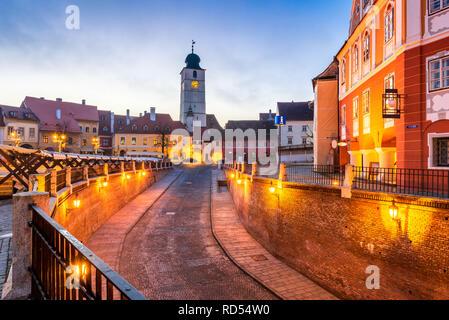 Sibiu, Romania - Lesser Square and Council Tower at twilight. Transylvania saxon city. - Stock Image