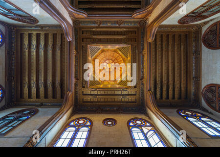 Wooden decorated dome mediating ornate ceiling with floral pattern decorations at Sultan al Ghuri Mausoleum, Cairo, Egypt - Stock Image