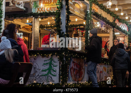Budapest, Hungary. 23rd Dec, 2017.  Christmas Fair at Vörösmarty square in Budapest Credit: Veronika Pfeiffer/Alamy - Stock Image