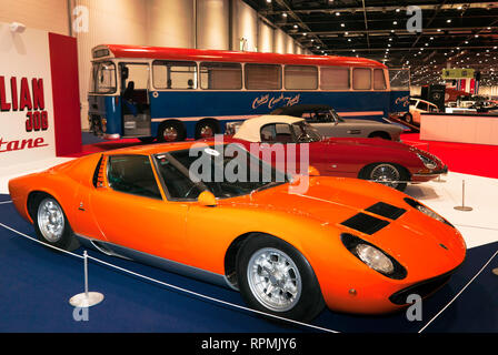 The Lamborghini Mura and two Jaguar E-types which all featured in iconic British film 'The Italian Job' on display at the 2019 London Classic Car Show - Stock Image