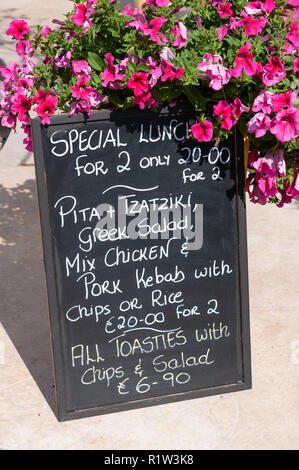 Lunch menu board outside taverna, Poseidonos Avenue, Paphos (Pafos), Pafos District, Republic of Cyprus - Stock Image