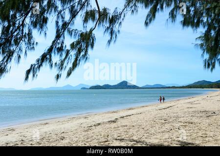 Couple walking on a sandy beach, Palm Cove, Cairns Northern Beaches, Far North Queensland, QLD, FNQ, Australia - Stock Image