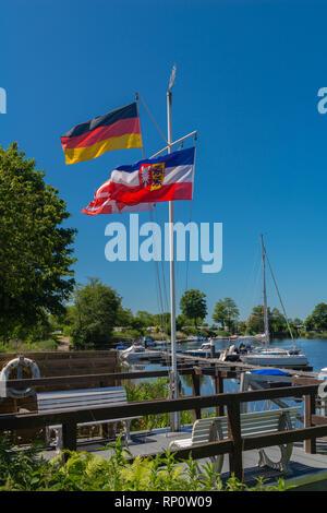 Small Sportboothafen or marina an der Eider, Eider-Treene-Sorge-Niederung or lowlands, Hennstedt, Horst, Dithmarschen, Schleswig-Holstein, Germany - Stock Image