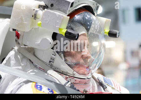 Commercial Crew Program astronaut Mike Fincke, in his spacesuit before entering the pool at the Neutral Buoyancy Laboratory for ISS EVA training in preparation for future spacewalks while onboard the International Space Station at the Johnson Space Center February 1, 2019 in Houston, Texas. - Stock Image