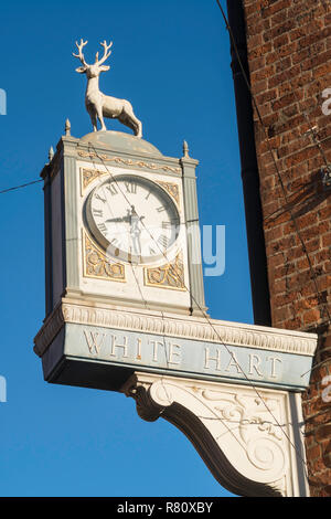 White Hart Hotel clock and sign, Lincoln, Lincolnshire, England, UK - Stock Image