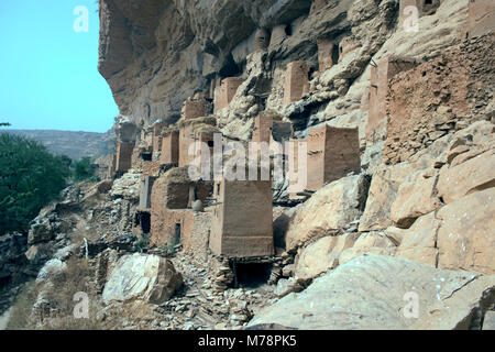 In former times the indigenous Dogon people of Mali, West Africa, lived high up in the cliffs for protection from - Stock Image