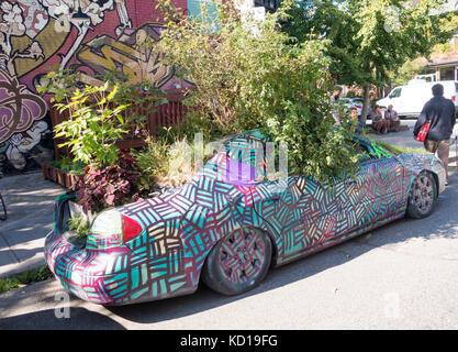 The Garden Car parked on Augusta Street in Kensington Market in downtown Toronto, Ontaario, Canada - Stock Image