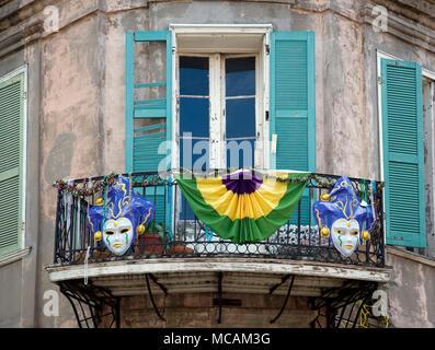 French Quarter Balcony During Mardi Gras - Stock Image