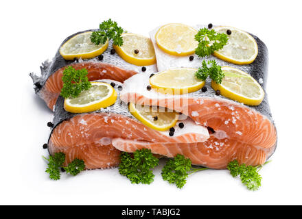Salted  salmon with lemon and spices isolated on white - Stock Image