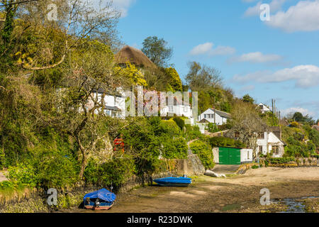 Houses beside the tidal inlet in the pretty Cornish vilage of Helford, Cornwall, England - Stock Image