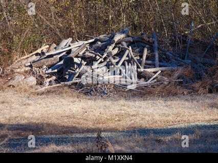 A pile of weathered and cut wood - Stock Image