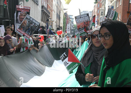 London, UK - 10 June 2018: Protestors take part in a demonstration outside the Saudi Arabia Embassy for Al Quds Day on 10 June 2018. The annual event held on the last Friday of Ramadan that was initiated in 1979 to express support for the Palestinians and oppose Zionism and Israel. Credit: David Mbiyu/ Alamy Live News - Stock Image