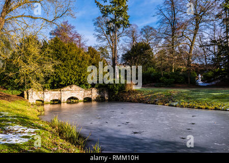 Shell Bridge and lake in the snow at Stowe, Buckinghamshire, UK - Stock Image
