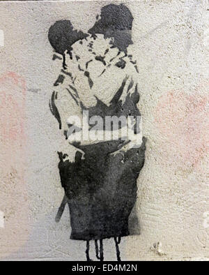 Banksy of two policemen kissing, the Vennel Edinburgh, Scotland, UK - Stock Image