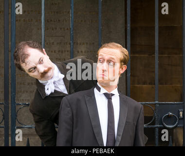 Edinburgh, Scotland, UK. 14th August 2018. Edinburgh Fringe Festival Photocall, Canongate Kirkyard, Royal Mile, Edinburgh, Scotland, United Kingdom. Winners of Show of the Week Award at VAULT Festival 2018, Dominic Allen and Simon Maeder present Providence, a dark comedy about the life and works of America's horror writer, HP Lovecraft by Turnpike Productions. Simon Maeder plays HP Lovecraft and Dominic Allen plays Edgar Allan Poe - Stock Image