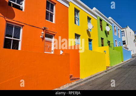 The colourful facades of the houses in Bo Kaap, Cape town.  View of major uphill side street. - Stock Image