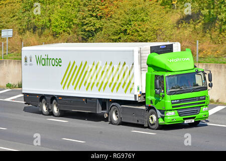 Side & front view Waitrose supermarket green hgv food supply chain store delivery lorry truck & driver  trailer with logo & Royal Warrant England UK - Stock Image