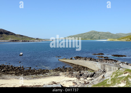Boat, slipway and beach at Hushinish with view over to Scarp - Stock Image