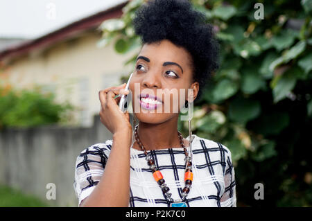 Young businesswoman smiling on the phone. - Stock Image