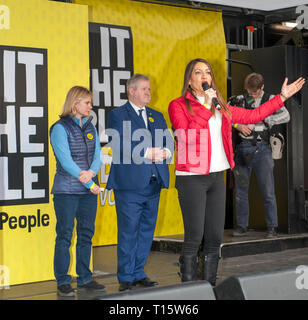 London, UK. 23rd Mar, 2019. Dr Rosena Allin-Khan Labour MP flanked by Justine Greening Conservative MP and Ian Blackford MP, SNP leader speaking at the People's Vote March and rally, 'Put it to the People.' Credit: Prixpics/Alamy Live News - Stock Image