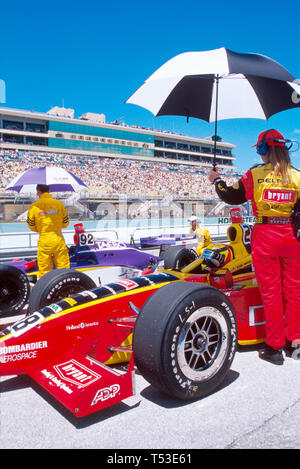 HomesteadMiami Florida Speedway Indy style race cars crew protects drivers from hot sun - Stock Image
