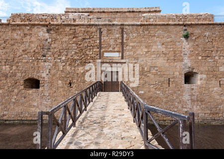 Entrance walkway across moat to Medieval Castle of Paphos, Paphos Harbour, Paphos (Pafos), Pafos District, Republic of Cyprus - Stock Image