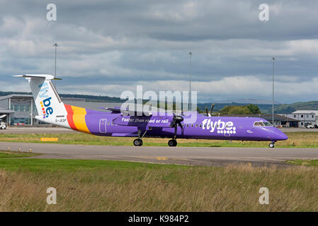 FlyBe Bombardier Dash 8 Q400 at Inverness airport ready for take off. - Stock Image