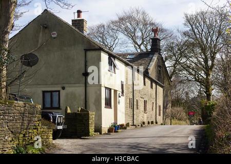 Farm buildings alongside a house for sale on Edge Lane, Entwistle. Entwistle is a hamlet near Edgworth, Lancashire. - Stock Image