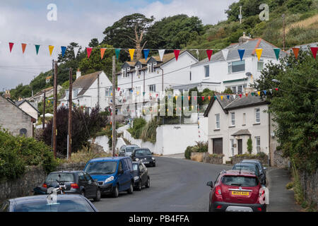 View along Main Road in Downderry, Cornwall, a small tourist village on the south coast - Stock Image