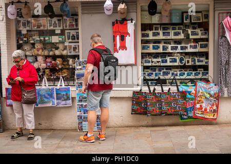 Gibraltar, Main Street, tourist browsing in souvenir shop - Stock Image