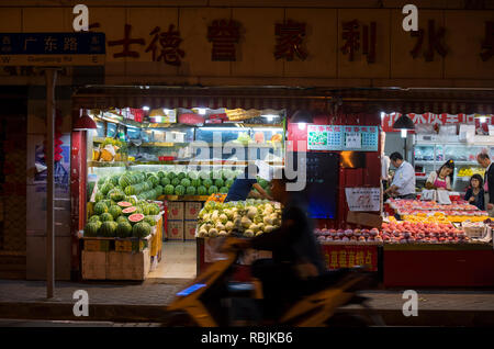 Night shot of a fruit shop in Shanghai, China - Stock Image