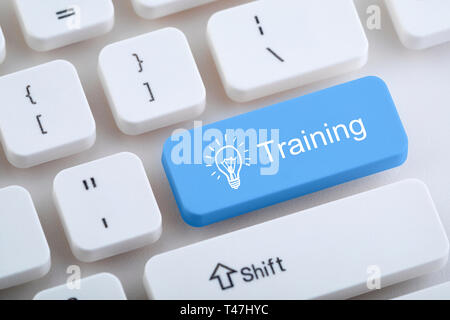 Computer keyboard with training button - Stock Image