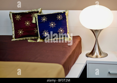 Cushions on the bed - Stock Image