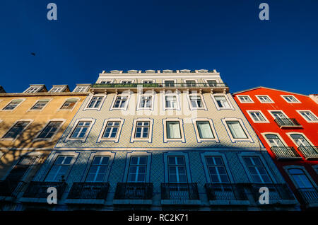 Traditional buildings with azulejo tiles in the old Lisbon neighbourhood of Alfama, Portugal. - Stock Image