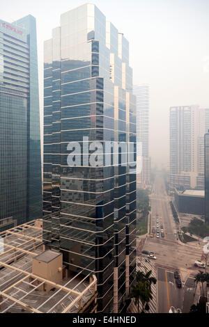 Smoke over downtown near 1221 Brickell Office high-rise building , Miami, Florida at Corner of Brickell Avenue and - Stock Image
