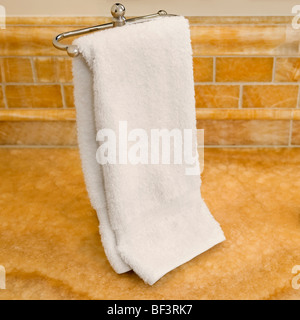 Towel hanging on the towel rail - Stock Image