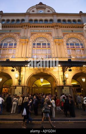 Spain Barcelona Ramblas opera house people facade illuminated at night - Stock Image