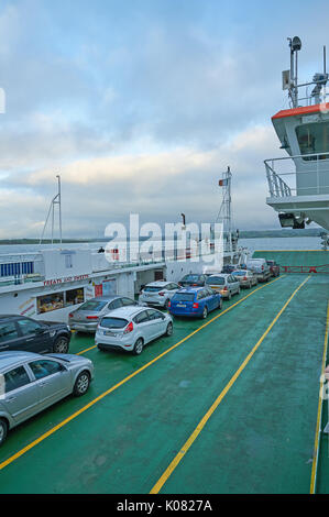 Cars on the ferry across the River Shannon running between County Clare and County Kerry in Ireland - Stock Image