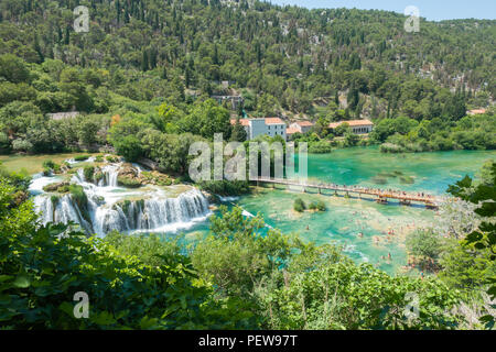 Skradinski Buk, Croatia. View on the waterfalls in Krka National Park with people swimming in the beautiful clear water. - Stock Image