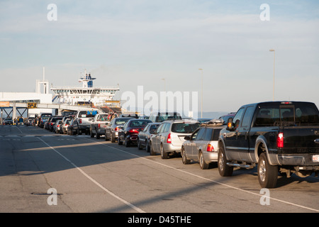 Queue of vehicles waiting to board BC Ferries Spirit of British Columbia, Port of Tsawwassen, BC, Canada - Stock Image