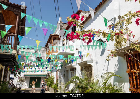 Cartagena Colombia Old Walled City Center centre Getsemani neighborhood narrow street paper banner decoration - Stock Image