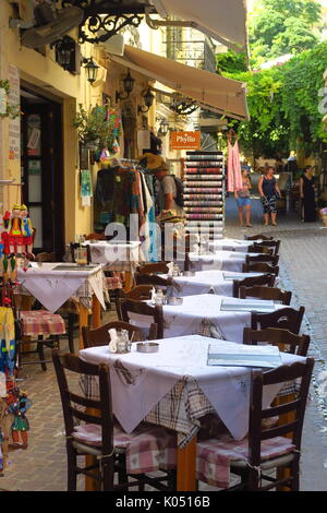 Tables and chairs outside a cafe in Chania on Crete - Stock Image